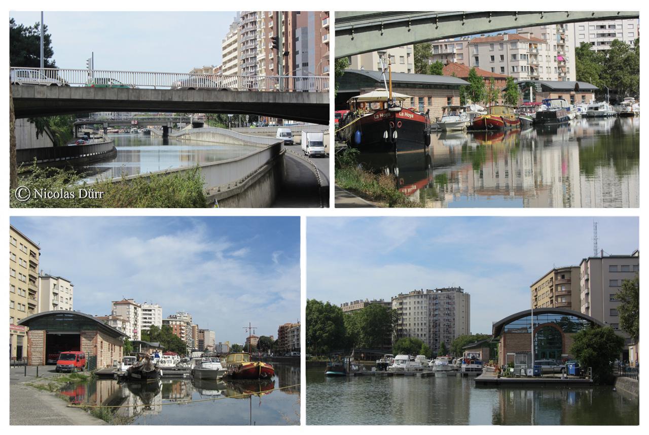 Le port St Sauveur et, au niveau du pont Guilhemery sur la photo en haut à gauche, l'emplacement de l'ancien port St Etienne. Le bâtiment des archives du Canal du Midi se situe à proximité (en données 2012).
